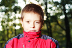 Boy in dark forest Stock Photo
