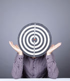 Boy with dartboard in place of head. Stock Photography