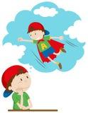 Boy daydreaming of being superhero Stock Image