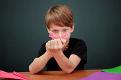 Boy daydreaming Stock Images