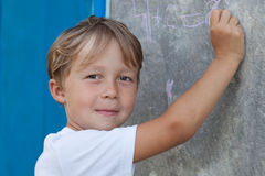Boy decides to arithmetic examples Stock Image