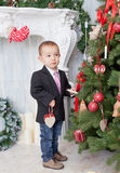 Boy decorate a Christmas tree Royalty Free Stock Photos