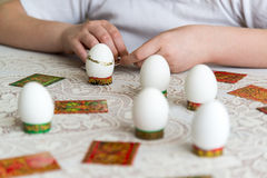 Boy decorate eggs for Easter with stickers Stock Image