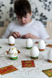 Boy decorate eggs for Easter with stickers Royalty Free Stock Photography
