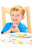 Boy Decorating Baked Biscuits Stock Photos