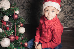 Boy decorating a christmas tree Royalty Free Stock Photography