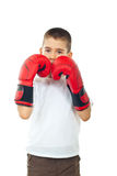 Boy defending with boxing gloves Royalty Free Stock Photo