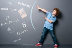 Boy defends himself from information stock photography