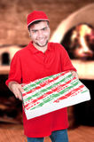 Boy delivering a pizza box Royalty Free Stock Photos