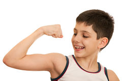 Boy demonstrates results of his exercises Royalty Free Stock Photos