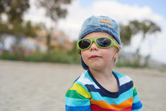 Boy in denim hat and sunglasses Royalty Free Stock Photography