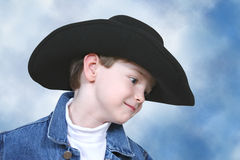 Boy in Denim Jacket and Black Cowboy Hat Stock Photo