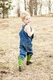 Boy in denim overalls smiling Stock Photos