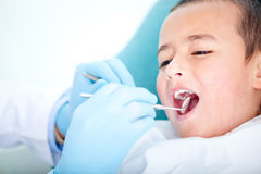 Boy at the dentist Stock Photos