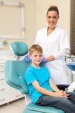 Boy on dentist chair. Handsome little boy sitting on dentist chair Royalty Free Stock Photo