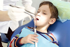 Boy and dentist during a dental procedure Royalty Free Stock Photos