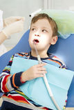 Boy and dentist during a dental procedure Stock Photography