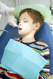 Boy and dentist during a dental procedure Stock Photos
