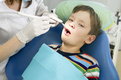 Boy and dentist during a dental procedure Stock Image
