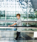 Boy in the departure hall Stock Photo