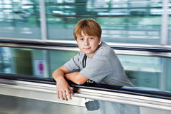 Boy in the departure hall  in the new Airport Royalty Free Stock Image