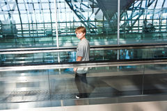 Boy in the departure hall Stock Photos