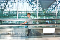 Boy in the departure hall Stock Image