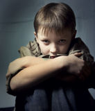 Boy in depression. On background royalty free stock photo