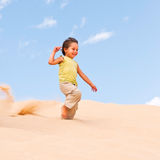 Boy in the desert Royalty Free Stock Photo