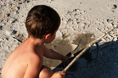 Boy in the desert. Exhausting heat. Royalty Free Stock Photos