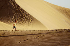 Boy in a desert Stock Image