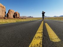 Boy in desert road. Stock Photos