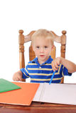 Boy at a desk Stock Image