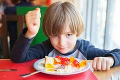 The boy with dessert dish Stock Image