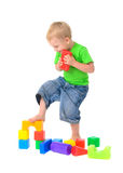 Boy destroys toy building Royalty Free Stock Photos