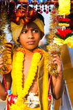 Boy devotee. 20 January 2011, Kuala Lumpur, Malaysia: A young boy devotee carrying the ceremonial kavadi as part of a thanksgiving ritual during the annual Stock Image
