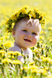 Boy with diadem from dandelions Stock Images