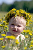 Boy with diadem from dandelions Stock Photo