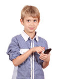 Boy dials on the phone Stock Photography