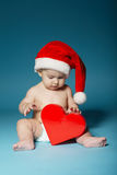 Boy in diapers with hat of Santa Claus Royalty Free Stock Photo