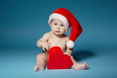 Boy in diapers with hat of Santa Claus Royalty Free Stock Photos
