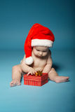 Boy in diapers with hat of Santa Claus Stock Image
