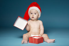 Boy in diapers with hat of Santa Claus Stock Photography