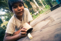 Boy with dice in Bolivia Stock Photo
