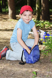Boy digging in bag Royalty Free Stock Photos