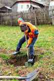 Boy digging in the ground Royalty Free Stock Photo