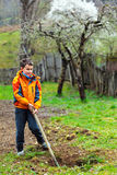 Boy digging in the ground Royalty Free Stock Images
