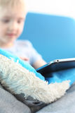 Boy and digital tablet Royalty Free Stock Images