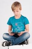 Boy with a digitizer Royalty Free Stock Photo