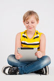 Boy with a digitizer Royalty Free Stock Images